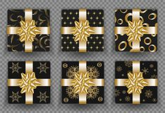 Christmas gift boxes with golden ribbon bow and gold wrapping pattern. Vector isolated gifts set for New Year or Christmas and Bir. Set of black gift box top Royalty Free Stock Images