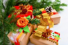 Christmas gift boxes with golden ribbon, white snowflake and fir stock image