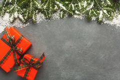 Christmas gift boxes on gray background. Royalty Free Stock Photos