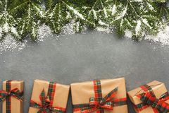 Christmas gift boxes on gray background. Stock Photos