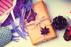 Christmas gift boxes, heart shape and fir cone Royalty Free Stock Photos