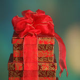 Christmas gift boxes with a holiday background. Elegantly wrapped Christmas presents set against a festive holiday background Stock Photo