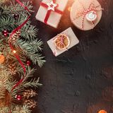 Christmas gift boxes on holiday background with Fir branches, pine cones. Xmas and Happy New Year theme, bokeh, sparking, glowing. Flat lay, top view, space stock photo