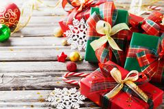 Christmas gift boxes with holiday decorations on wooden background. Christmas gift boxes with holiday decorations on rustic wooden background royalty free stock photo