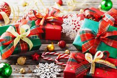 Christmas gift boxes with holiday decorations on wooden background. Christmas gift boxes with holiday decorations on wooden rustic background stock image