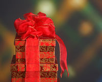 Christmas gift boxes with holiday lights. Beautifully wrapped Christmas presents against a holiday themed background Stock Photo