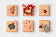 Christmas gift boxes with homemade wrapping ideas.View from above. Royalty Free Stock Photo