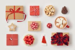 Christmas gift boxes and hot chocolate cup on white background stock images