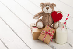Christmas gift boxes and milk for Santa Stock Photos
