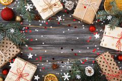 Christmas gift boxes over decorated table with sparkle stars, fe. Christmas gift boxes over decorated festive table with sparkle stars & ornaments. Frame of stock image