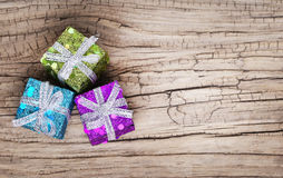 Christmas gift boxes over grunge wooden background Royalty Free Stock Image
