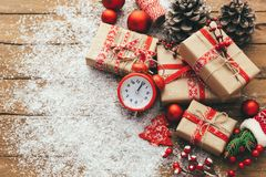 Christmas with gift boxes over wooden background. Christmas with gift boxes and festive decorations, on wooden table. Holiday background. Flat lay. top view with Stock Images