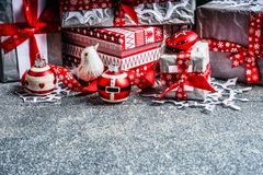 Christmas gift boxes with paper and red ribbons on gray rustic background Stock Images