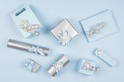 Christmas gift boxes in pastel blue and silver metallic color with ribbons and bows, top view, pattern, festive background. Christmas gift boxes in pastel blue royalty free stock photography