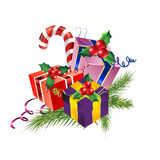 Christmas gift boxes  with pine, holly, cane, ri Stock Photography