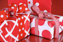 Christmas gift boxes on red background. Closeup. Royalty Free Stock Image