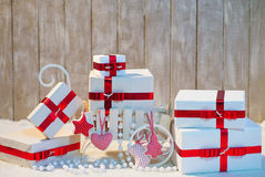 Christmas gift boxes with red ribbon bows Stock Images