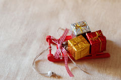 Christmas gift boxes on a red sleigh Royalty Free Stock Image