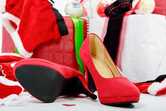 Christmas gift boxes and red woman shoes Royalty Free Stock Photo