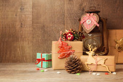 Christmas gift boxes and rustic ornaments on wooden table stock photo