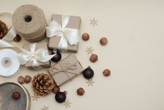 Christmas Gift boxes Rustic Style, and Eco Decorations on a old wooden background. Pine cones, Nuts. Copy Space. top View. royalty free stock photo
