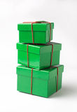 Christmas gift boxes. A set of three festive gift boxes stacked on top of eatch other. Objects on white background Royalty Free Stock Photography