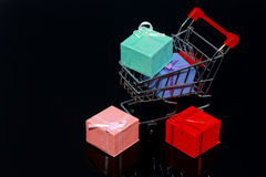 Christmas Gift boxes in shopping cart isolated Stock Photo