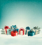 Christmas gift boxes in snow. Royalty Free Stock Photos