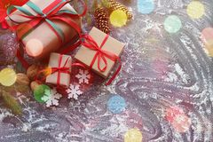 Christmas gift boxes and snow white background with copy space. royalty free stock photo