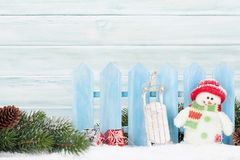 Christmas gift boxes, snowman toy and fir tree branch. View with copy space Royalty Free Stock Photo