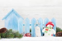 Christmas gift boxes, snowman toy and fir tree branch. View with copy space Stock Photo