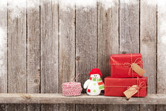 Christmas gift boxes and snowman toy Royalty Free Stock Photo
