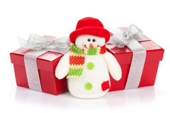 Christmas gift boxes and snowman toy Royalty Free Stock Photos