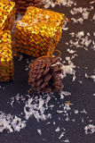 Christmas gift boxes with spruce twigs and cones Royalty Free Stock Photo