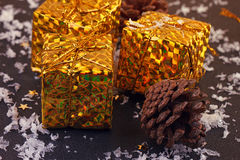 Christmas gift boxes with spruce twigs and cones Royalty Free Stock Photos