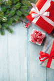 Christmas gift boxes and tree branch Stock Images
