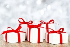 Christmas gift boxes with twinkling background Royalty Free Stock Photography