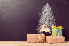Christmas gift boxes under tree drawing on chalkboard. Alternative Christmas tree background. Concept stock photo