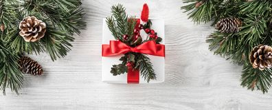 Christmas gift boxes on white wooden background with Fir brancheChristmas gift boxes on white wooden background with Fir branches,. Christmas gift boxes on white royalty free stock image