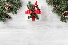 Christmas gift boxes on white wooden background with Fir branches, pine cones. Xmas and Happy New Year theme. Flat lay, top view, space for text stock photos