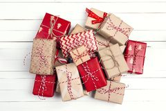Christmas gift boxes on white wooden table. Top view stock image