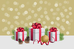 Christmas gift boxes wirh decorations and fir branches on golden. Christmas gift boxes and decorations Royalty Free Stock Images