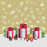 Christmas gift boxes wirh decorations and fir branches on golden. Christmas gift boxes and decorations Royalty Free Stock Photography