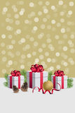 Christmas gift boxes wirh decorations and fir branches on golden. Christmas gift boxes and decorations Stock Photography