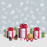Christmas gift boxes wirh decorations and fir branches on silver. Christmas gift boxes and decorations Royalty Free Stock Photos