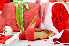 The Christmas gift boxes and woman shoes Stock Photo