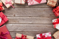 Christmas gift boxes on wooden table Stock Photography