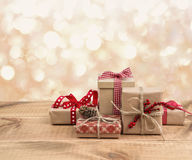 Christmas gift boxes on wooden table over abstract lights background.  Royalty Free Stock Photos
