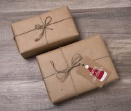 Christmas gift boxes wrapped in kraft paper, with blank gift tag Stock Image