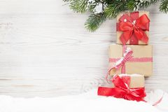 Christmas gift boxes and xmas fir tree. Branch. View with space for your greetings Stock Photography